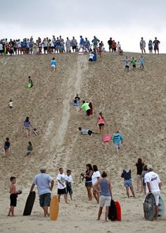 Jockeys Ridge State Park, Outer Banks, NC- hang glide, fly kites, and sled down the big dunes.