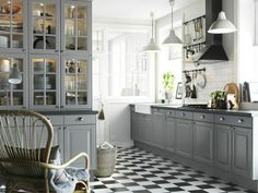 Cool kitchen. Love the gray and the white. I would do a wood floor.