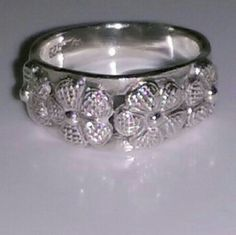 authentic SS flower ring Sterling Silver Flower Ring Size 6 (estimated)  Thick, great quality stamped ss ring.  I just polished it.  There are no scratches or signs of wear.  Gorgeous 3D flowers pop off the ring.  Jewelry * SS * Rings * Stamped * Flowers * Floral * Gir Sterling Silver Jewelry Rings