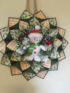 Handmade red and green paper cone wreath. The inside of each green cone has a red holly berry print and music sheet paper. The center has holiday floral with a snowman in the middle. 12 inches in diameter. Christmas Makes, Christmas Snowman, Christmas Holidays, Christmas Ornaments, Wreath Crafts, Christmas Projects, Holiday Crafts, Christmas Patchwork, Christmas Sewing