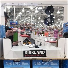 This Kirkland Sunglasses Pallet Built-In Mirror save the time and trouble of having customers look around for a store mirror to see how they look in. Retail Fixtures, Store Fixtures, Costco Store, Pallet Building, Retail Merchandising, Point Of Purchase, Retail Design, Store Design, Sunglasses