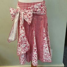 SALE! Checkered skirt with a tie . NWOT checkered and floral skirt with a tie on the sides that can not be removed  ... make a cute bow or just a cute knot. Chupchick Skirts Midi