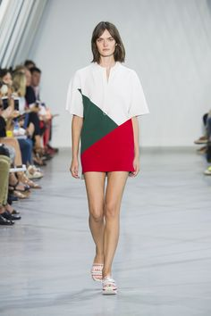 Colorful dress with bright graphic shapes from the #LacosteSS16 fashion show. ©Yannis Vlamos