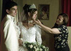 The tearful daughter of Romania's Roma King Florin Cioaba, Princess Ana Maria (C) 12, is comforted by a photographer (R) as she has her wedding pictures taken alongside her 15-year-old groom, Birita Mihai, during their lavish wedding in Sibiu, 250km northeast of Bucharest. The unwilling bride, whose marital age is common among Romania's traditional Roma who are estimated between 500,000 and three million, walked out of the ceremony and had to be convinced to return by her relatives on 7 Sep…