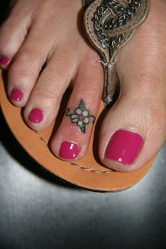 "Small ""toe ring"" flower tattoo on the toe/foot"