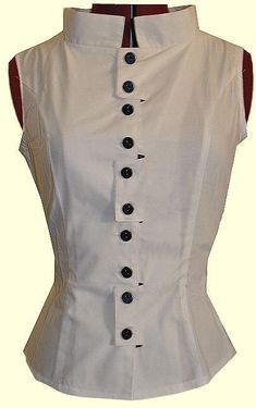Fitted white peplum top with black buttons as embellishment.