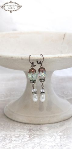Boho Wedding Pearl Crystal Earrings, Bridal Vintage style Earrings, Victorian Earrings Earrings, Shabby Chic Earrings Features : Vintage faux pearls , Vintage Czech Aqua - Mint iridescent Crystal beads , antique copper findings , and antique rhinestones With antique copper lever