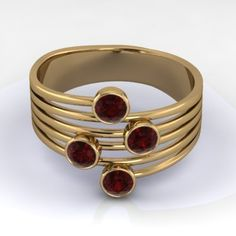 14K Yellow Gold Round Bezeled Stacked Ring with  Rubies. With elegant and modern design this ring features four 3.1mm brilliant cut stones. It looks like there are multiple rings, but in fact its just one!