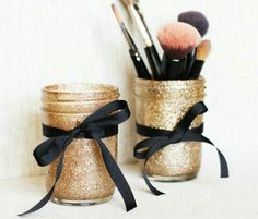 Make up organizers made from mason jars glitter and ribbon