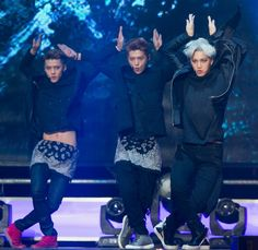 Members of South Korean-Chinese boy band EXO-M strike their comeback pose during a performance on April 15 in Seoul, South Korea