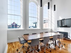 Solid walnut conference table by Brush Factory. Chairs Andreau World  This is the 4th floor conference room in the amazing three building renovation project for Cintrifuse and the Brandery and UpTechIdeas in Cincinnati Ohio  Photo: Ryan Kurtz