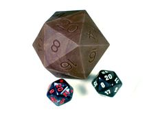 Hey, I found this really awesome Etsy listing at https://www.etsy.com/listing/177053219/huge-chocolate-d20-dice-with-actual-d20