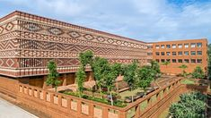 Studio Lotus creates patterend brick facade for Indian government building Government Architecture, Brick Architecture, Indian Architecture, Cultural Architecture, Amazing Architecture, Lotus, Agricultural Practices, Passive Design, Thermal Comfort