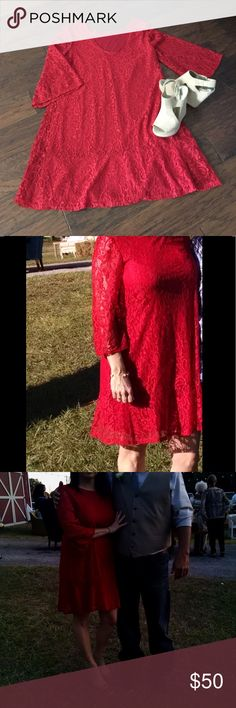 "Worn once to a wedding...no longer fits Red lace overlay, bell sleeves, and scoop back...Great for outdoor event...I'm 5'4""... falls just above my knees...super comfy...bought online from simply dresses... would look awesome with tan wedges or cowboy boots!! Made in USA!! Tiana B. Dresses Midi"