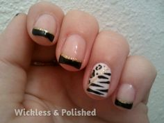 Elegnt black french tips with animal prints nail art