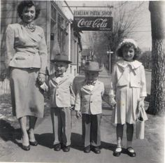 Sunday best 1950s. looove that Every body has a hat on!!! I don't think i've seen little boys in hats like these 2!!!!!