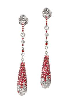 Drop Earrings from The Manhattan Collection: hand made 925 sterling silver plated with silver rhodium, hand-set with red sapphires and white topaz.