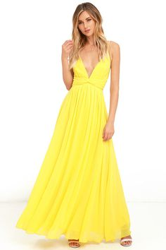 The magical effect of the Evening Dream Yellow Maxi Dress is undeniable! Adjustable spaghetti straps support a woven triangle bodice with gathered detail, bit of elastic at back, and tying sash at the waist. Full maxi skirt is lined with a layer of organza for added drama. Hidden back zipper with clasp.