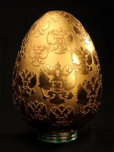 Gold Imperial Faberge Egg? No. Not all eggs are Faberge and not all Faberge eggs are imperial. There are about 50 true imperial eggs, the ones which the emperors presented either to his wife or mother. Some of them are disappeared. Apart from these, Faberge made other eggs to non-royal families (Kelch, Yussupov, Rothschild etc). They're not imperial eggs. This egg is not Faberge and certainly not imperial.