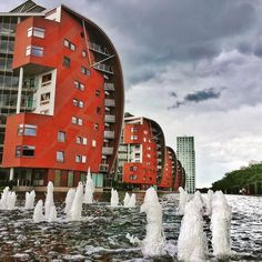 What do these buildings look like? #citytrip #denbosch #shertogenbosch #thenetherlands #armada #paleiskwartier #appartments #water #fountain #sailboat #sailship #building #urbancity #instaphotography #clouds #dutchweather #singingintherain #dayout #fun #daytrip #beautiful #beautifulplace #beautifulplaces #loveit #beautifulcity #architecturephotography #lovethiscity #architecturelovers