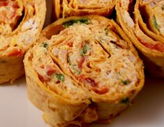 Chicken Enchilada Dip Rollups! Great tailgating food!