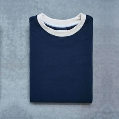 COLORBLOCK sweatshirt, navy with cream details. Small embroidered DOTT. logo. Nice and soft on the inside. Made in the Netherlands by talented, experienced men with a refugee background. Get it NOW at www.dottshop.nl