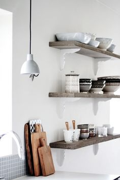 "Paint shelf brackets same color as walls. Shelf will appear more ""floating"". Wood shelf"