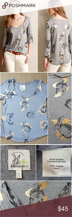 """Pop Print Rabbit Tee Porridge Sullivan Anlyan Top Anthropologie Porridge Pop-Print Tee Shirt Top Featuring a cheery rabbit/bunny print with gold foil from artist Sullivan Anlyan, this festive gray 3/4 sleeve tee is a beyond-basic charmer. Excellent condition! No holes, no tears, no stains, see pics!  Viscose-rayon jersey Roll-tab sleeves Style No. 4112059681554  Size: Small Width (armpit to armpit): approx 18.5"""" Length: approx 25"""" Sleeve length: approx 18"""" Materials: 100% Viscose/Rayon…"""