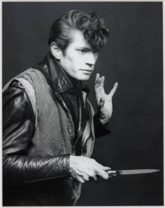 Robert Mapplethorpe sporting an impressive teddy-boy quiff in this Self Portrait, 1983