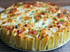 "Baked Alfredo Rigatoni Pie Baked rigatoni in ""pie"" form, covered in a creamy, cheesy alfredo sauce."