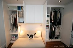 This is a custom made wardrobe built in a London flat across two alcoves and a chimney breast. From the outside it looks like the wardrobe is on a flat wall, but when you open the doors you can see deep hanging on the right and on the left you have deep storage shelves. This bespoke wardrobe was built by EMPATIKA.uk http://www.Empatika.uk