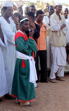 """https://flic.kr/p/6mJfvJ   sudan - the whirling dervishes of omdurman   The whirling dervishes of Omdurman.  Sheikh Hamed al-Nil was a 19th-century Sufi leader of the Qadiriyah order, and his tomb is the weekly focus for Omdurman's most exciting sight - the dancing and chanting dervishes. Each Friday afternoon before sunset, adherents of the Qadrriyah order gather to dance and pray, attracting large crowds of observers and participants. The purpose is a ritual called """"dhikr"""". The &..."""