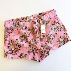Floral Denim Shorts Antique-inspired denim shorts with cuffed hems. Five pockets & button fly. 100% cotton. They are a size 28 (which I normally wear) but they fit a little bit smaller. Forever 21 Shorts Jean Shorts