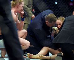 Holly Holm, left, watches Ronda Rousey, right, … Ronda Rousey, Holly Holm Ufc, Duke City, Ufc Boxing, Ufc Women, The Blues Brothers, Latest Gossip, Female Fighter, Mixed Martial Arts