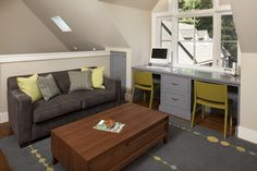 bonus room desk under the window with tall storage on each side