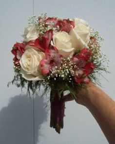 Gorgeous pink and burgundy alstromaria with cream roses and baby's breath