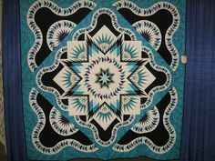Glacier Star designed by Quiltworx.com, made by Colleen Robert.  One of three award winning quilts, this one placed 2nd at the 2014 Linn Country Fair.