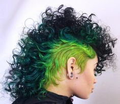 black, teal, green, and yellow dyed hair