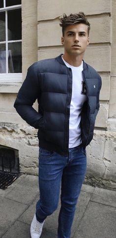 Fall fashion with a navy puffer jacket white printed t shirt denim white sneakers  #pufferjacket #whitesneakers #denim #jacket #menswear #mensfashion #menstyle #fallfashion #falloutfits #tshirt