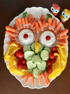 Yummy veggies! Shape of an owl. Carrots, cucumbers, tomatoes, peppers, ranch dip dressing  Fun vegetable plate, animal, bird, owl theme party or picnic theme easy and quick!
