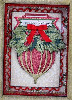 Anna Griffin ornament with patterned paper layer under overlayer of ornament