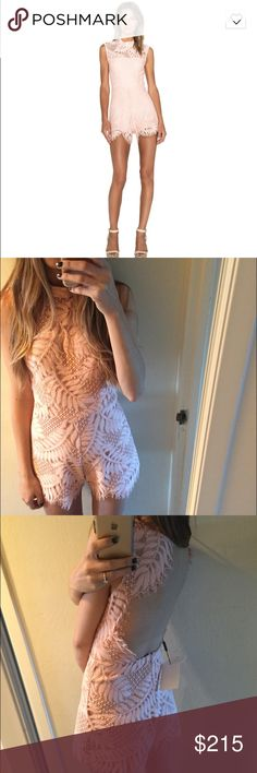 Alexis X Revolve Lucia Lace Romper in blush leaf Absolutely gorgeous blush pink lace Alexis romper (lace is tropical leaf print), with high neck and open back with scalloped edges. Worn once on my bachelorette party at received so many compliments. One of the prettiest things I've ever owned! Alexis Dresses