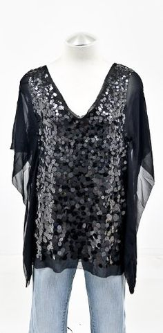 BCBGMAXAZRIA Black Silk Tunic DressFrom #BCBGMAXAZRIA List Price: $238.00Price: $139.99 Availability: Usually ships in 2-3 business daysShips From #and sold by R.Chameleon