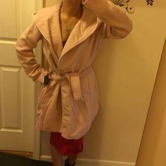 """Steve Madden pink winter coat BNWT $175 Has hood and one magnetic button in middle of coat in front. Pockets on the side. Shoulders: 4"""" sleeves: 25"""". Looks like a shirt trench coat. Extremely warm and thick. 33"""". White trim in front. Made of polyester and rayon inside. Very stylish and very well made. You can really dress this up for a co derivative event or just running around the city. The new trend is accessories, play it up!  I love how easily you can change the look. Plus everyone…"""