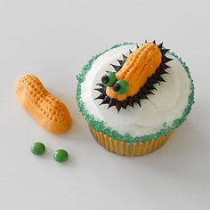 Halloween recipes: Sweet Slug Cupcakes made by decorating a store-bought cupcake with M&Ms and Circus Peanut candies