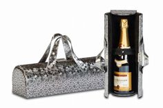 Go out & hit the town with a fashionable Carlotta Clutch Wine Bottle purse. You will be the envy of all your friends during Girl's night out, date night, or just traveling to your favorite restaurant with this stylish wine bottle purse design. Soft sueded lined with an elastic inside pocket to hold keys, ID and more. The Carlotta Clutch securely holds 1 bottle with the elastic inside strap. Carry it as a purse....only you will know what's really inside! www.facebook.com/cisportsinc