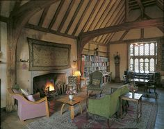 Great Dixter, Rye, England. The Solar was the principal private apartment of the medieval house. The fireplace dates from the late 15th century and its spandrels bear the devices of the Lewknors of Bodiam (a hawk's lure) and the antlered head of the Windsors, who inherited Dixter about the time the fireplace was installed.