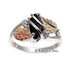 Black Hills Gold on Silver Ladies Ring With Onyx Size 9  Material: 925 sterling silver, 12k gold  Measures: 10 mm wide at widest point  Stones: black onyx