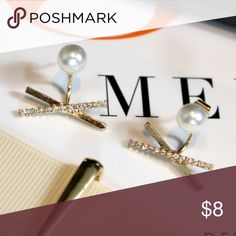 Pearl Studded Bar X Earrings Limited Stock! Classy pearl studded earrings with diamond 'X' bar.  Color: Gold.  Comes in a small jewelry box.   Material:  Fashion jewelry Jaded Affairs Jewelry Earrings