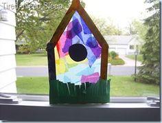 Birdhouse Suncatcher - Craft Stick Frame, Construction Paper Grass, and Tissue Paper stuck onto Clear Contact Paper